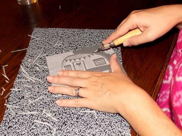 Carving the linocut block