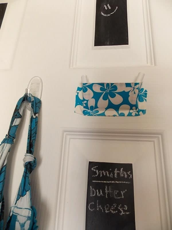 Small chalkboard on pantry door for grocery list