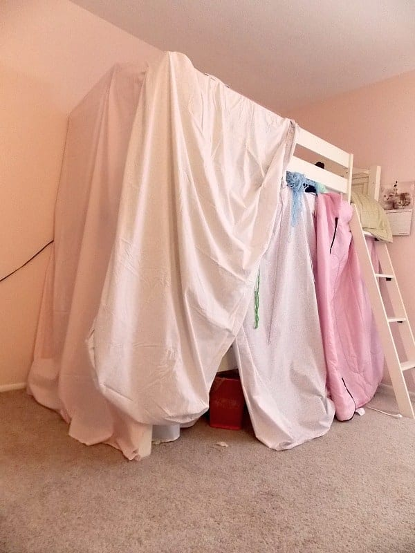 Before: bunk bed fort made out of sheets and blankets thrown over the bed