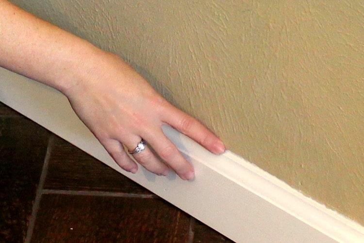 Smoothing caulk with fingertip