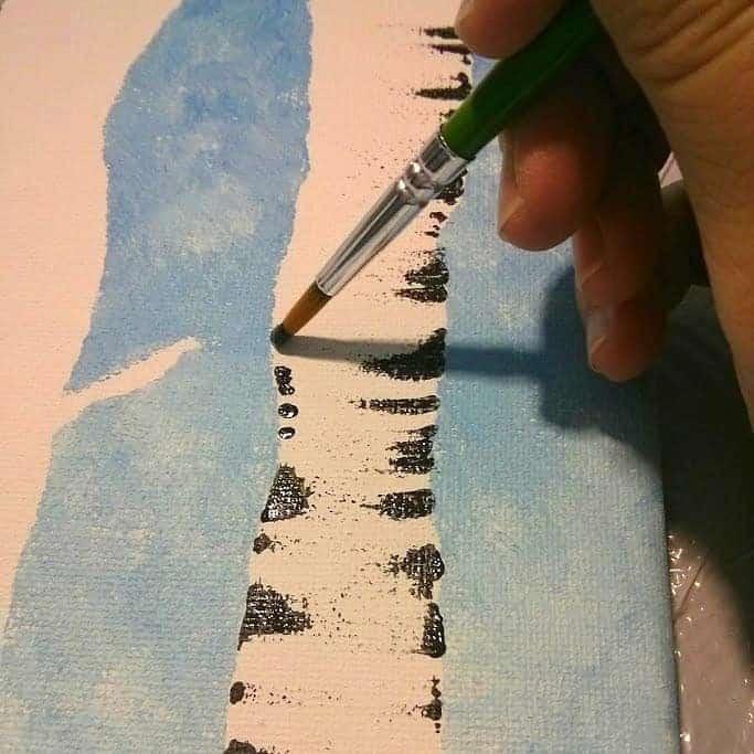 Painting bark on aspen trees