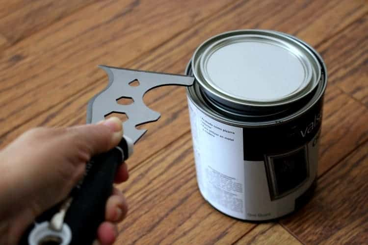 Painter's Tool prying lid off paint can
