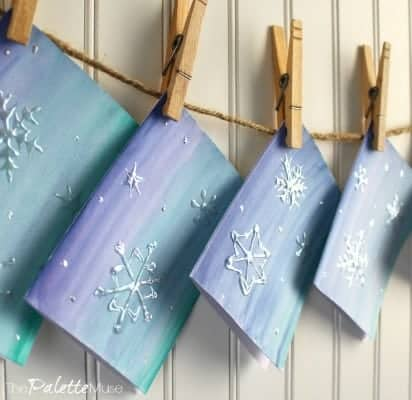Snowflake greeting cards hanging to dry on a line