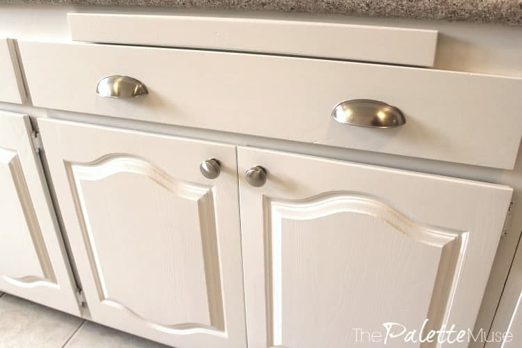 silver handles on white painted kitchen cabinets