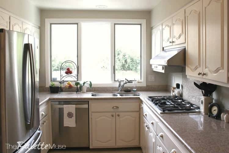 finished painted white kitchen cabinets with granite counter tops