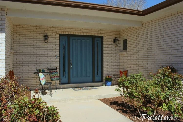 A new front door color makes this front porch bright and welcoming.
