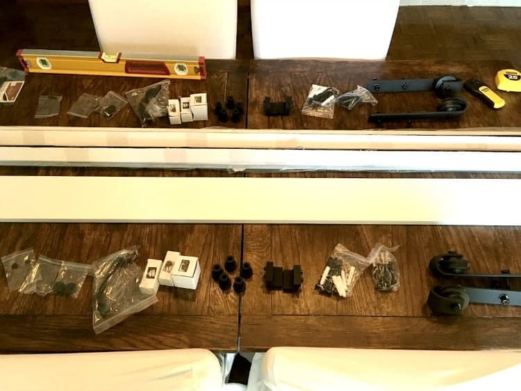 Barn door assembly parts laid out on table