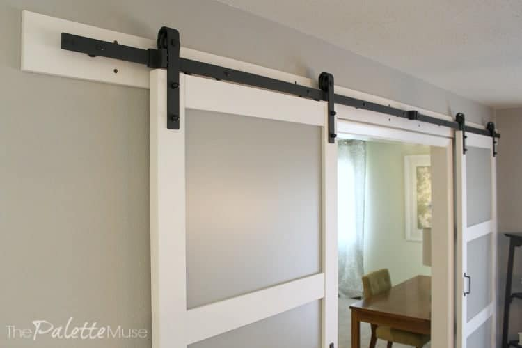 Detail of barn door's black iron header
