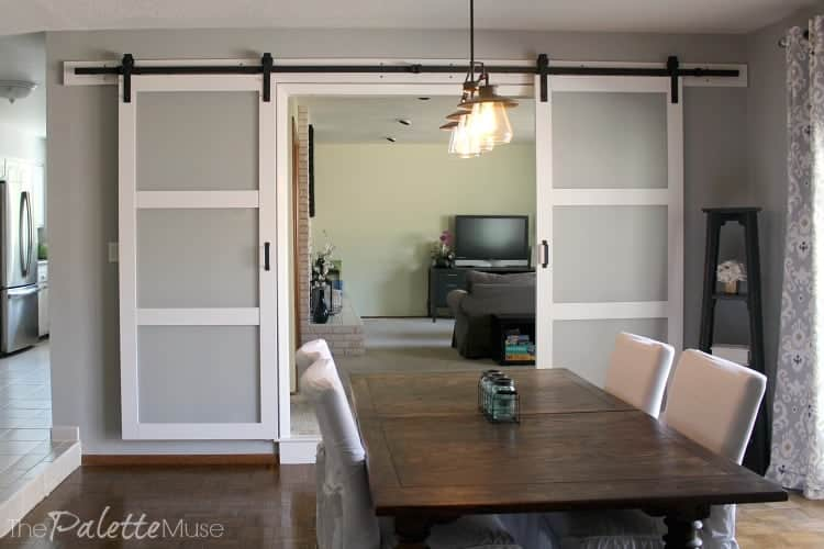 White and frosted glass double barn doors in the dining room