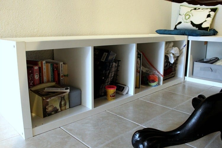 breakfast nook bench seat with cubbies full of odds and ends