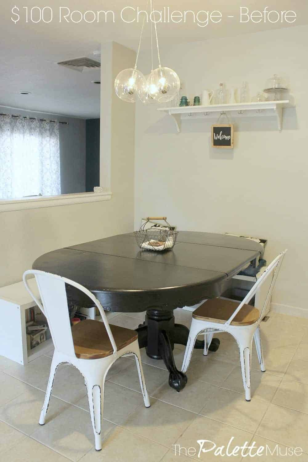 Breakfast Nook before makeover with black table and white chairs.