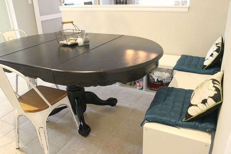 black dining table with white bench seating
