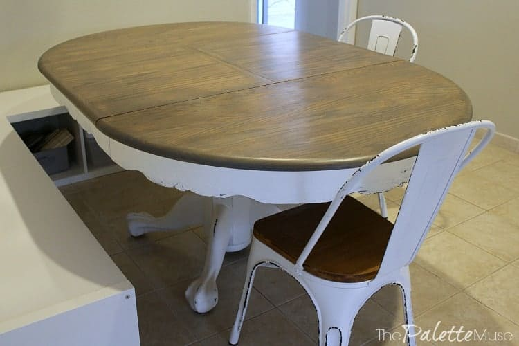 Finished gray and white farmhouse table and matching chairs.