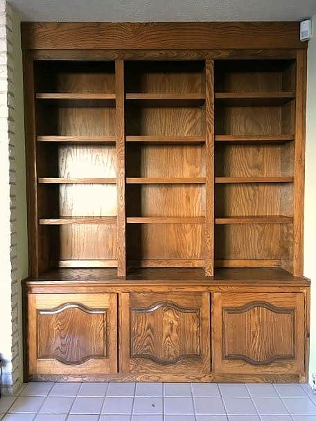 Dark brown built in bookshelves with cabinets on the bottom section