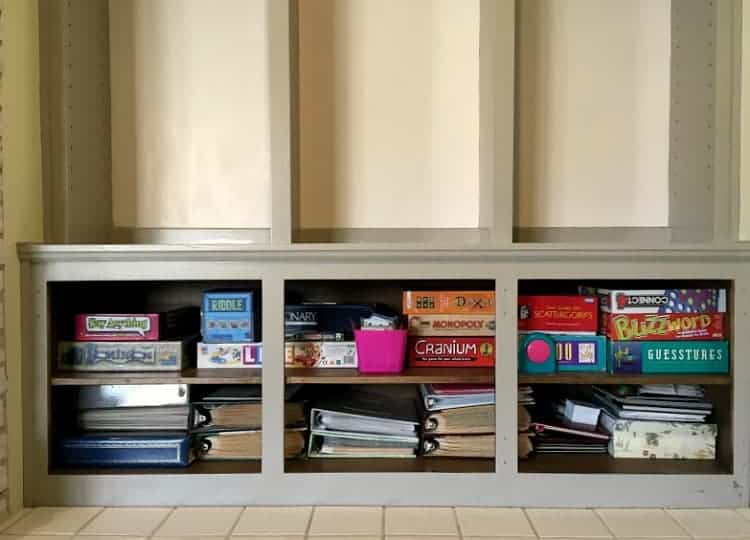 Painted bookshelves with organized contents