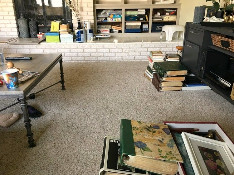 Contents of painted bookshelves all over the floor while paint dries