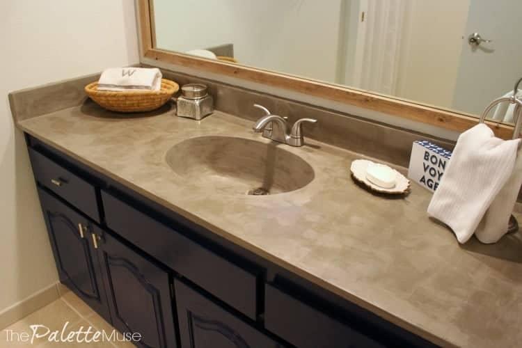 DIY concrete countertop on dark blue bathroom vanity
