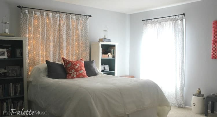 A lit headboard creates a faux window treatment behind the bed