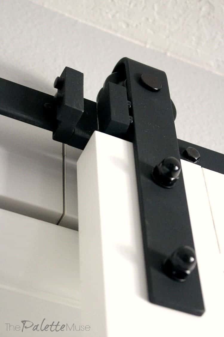 Detail of black wrought iron barn door hardware