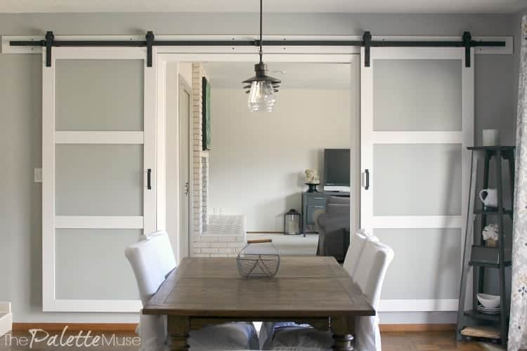 White double barn doors in dining room