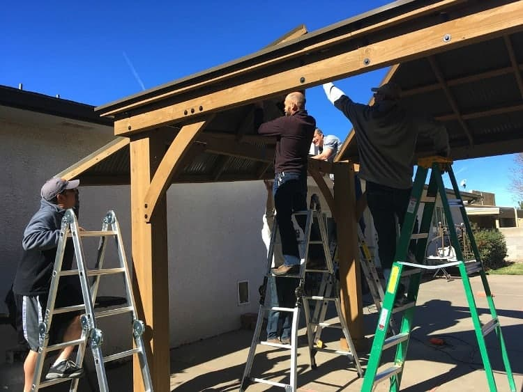 Lifting the roof panels onto a Yardistry gazebo takes several people
