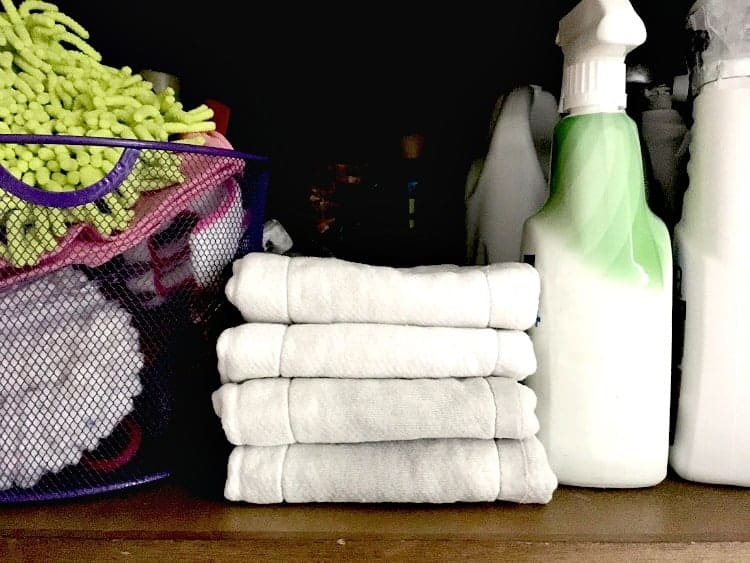 Cleaning hack - stack of folder cloth diapers on cleaning closet shelf