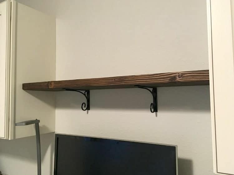 Shelf brackets and stained wood shelf
