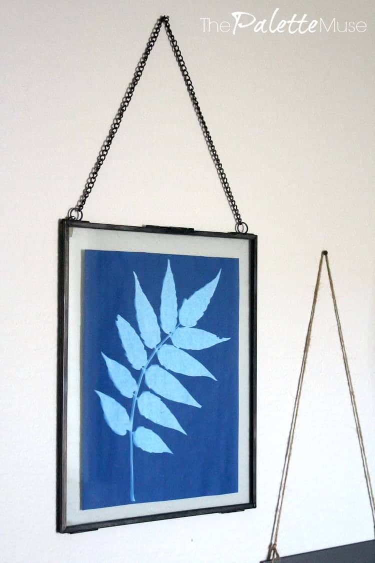 Solar print framed in metal and glass hanging from for the home office makeover.
