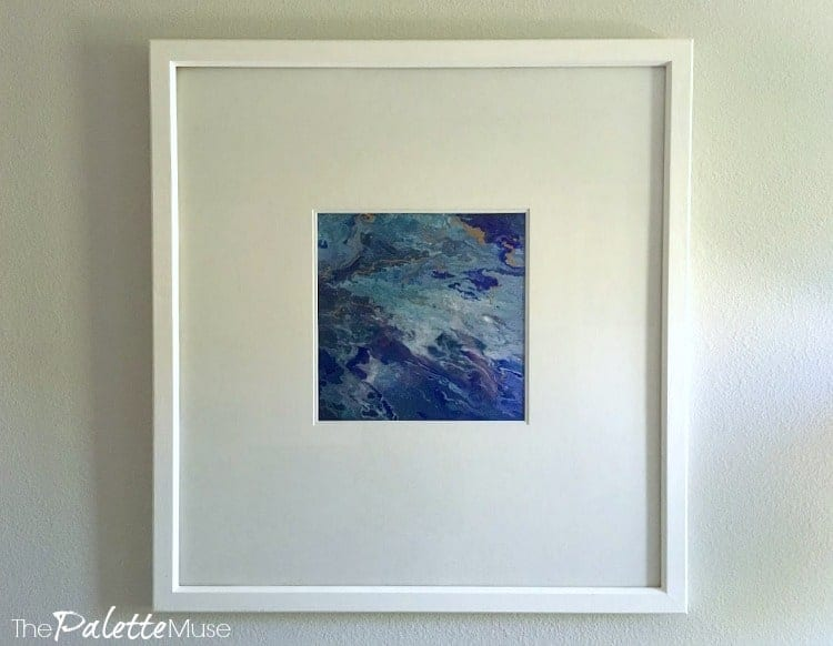 Closeup shot of blue poured acrylic painting in white frame