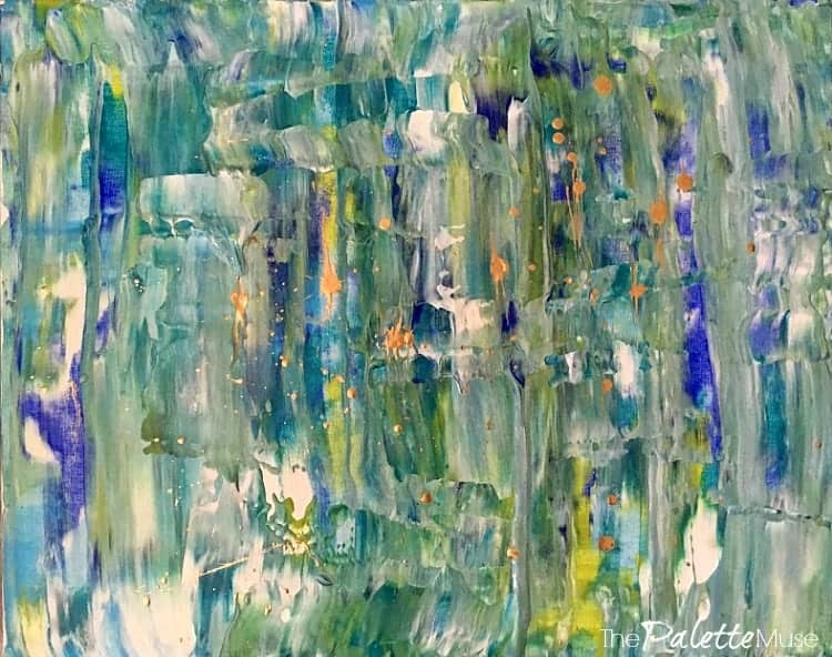Blues and greens in an abstract design on a canvas