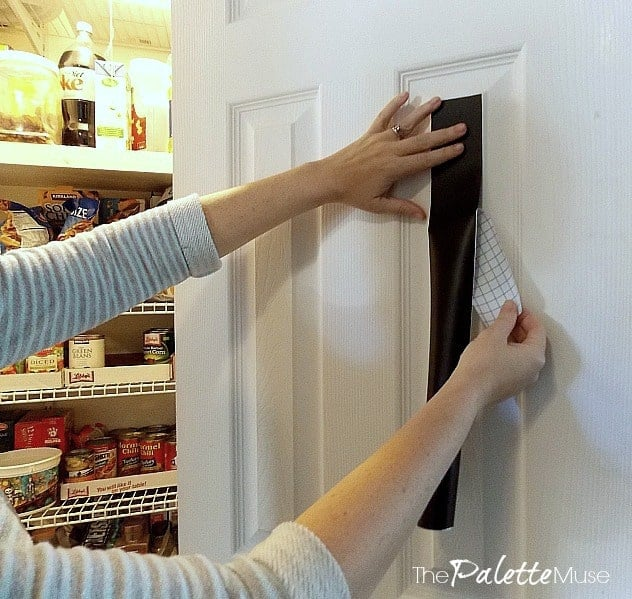 Applying chalkboard paper to the inside of a pantry door for grocery lists.