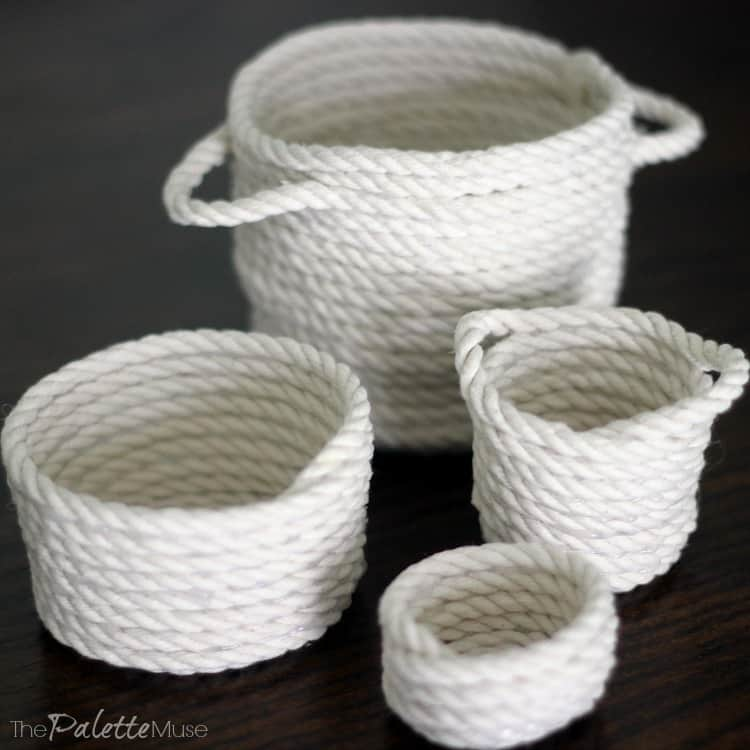 White mini rope baskets on dark background