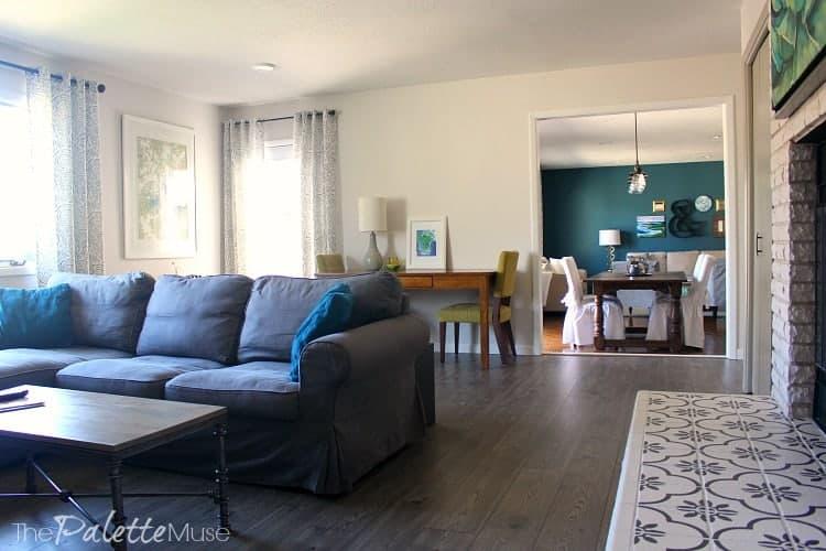 A cozy den with Anchor Gray laminate flooring by Pergo