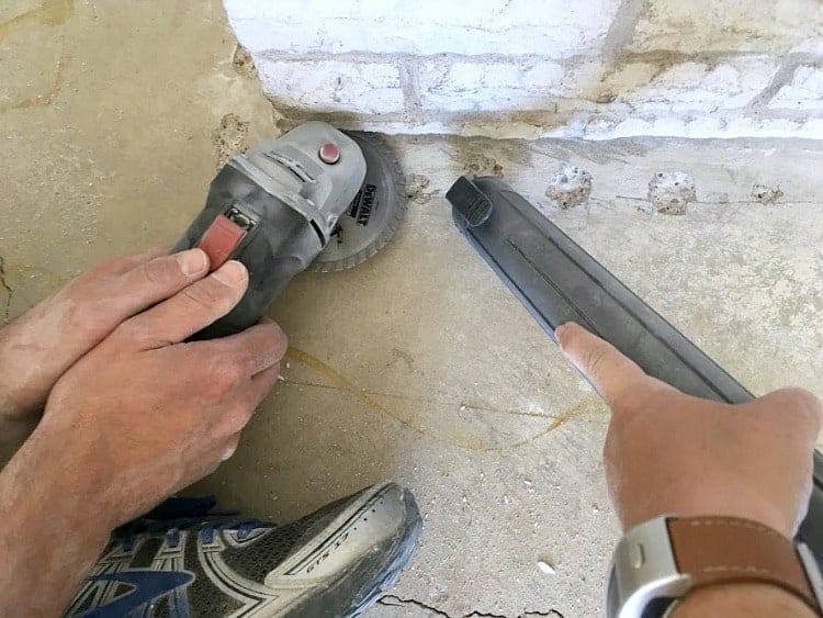 Undercutting stone hearth for installing laminate flooring