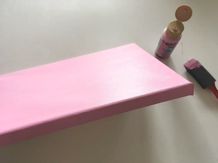 pink painted canvas, with edges covered in pink