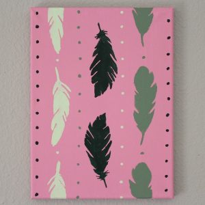 Green feathers and dots painted on pink background