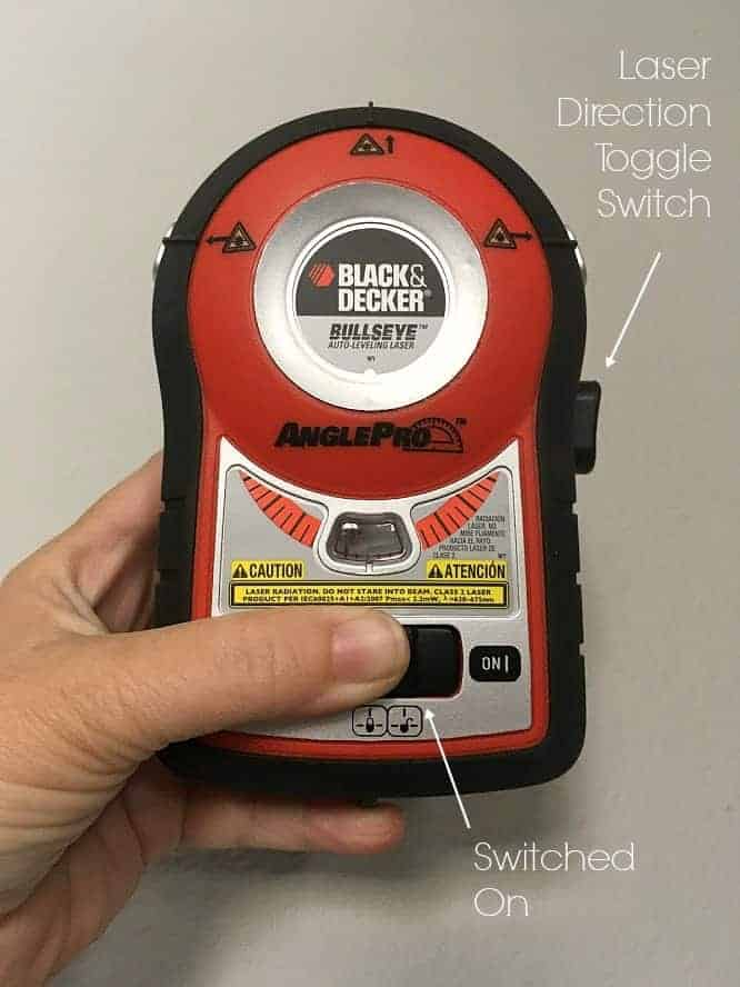 Black and Decker Bullseye laser level with on switch and direction switch labeled.