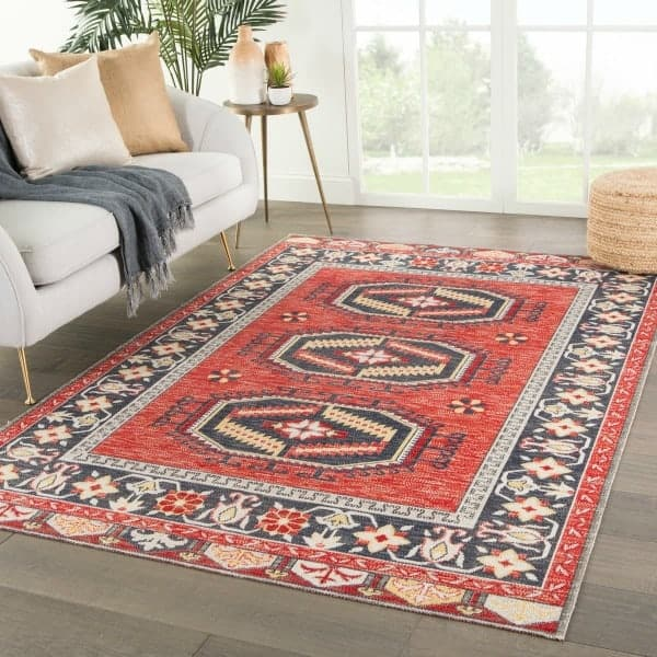 Red outdoor rug with traditional kilim pattern