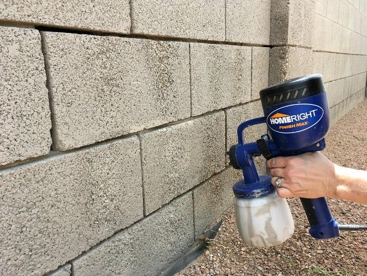 Homeright Finish Max sprayer spraying concrete block wall