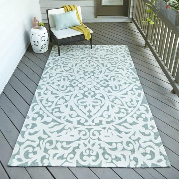 Aqua and white patterned outdoor rug