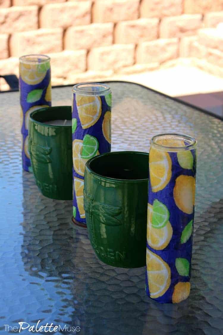 Blue and green candles make an outdoor centerpiece