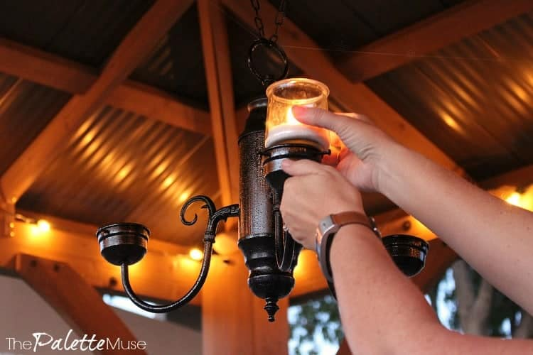 Setting a candle into a hanging candelabra