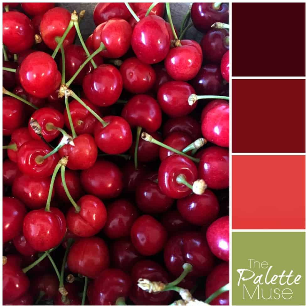 Bright red summer cherries lend their hues to this bold palette of reds. #summer #colorpalette #thepalettemuse