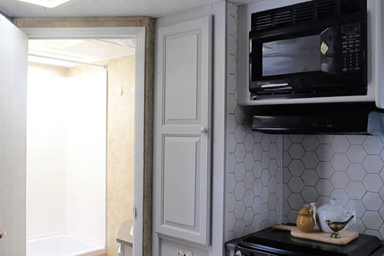 A view of the camper kitchen and bathroom