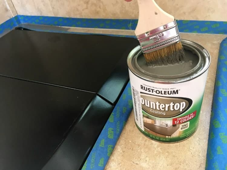 Painting countertops with Rustoleum's countertop coating paint.