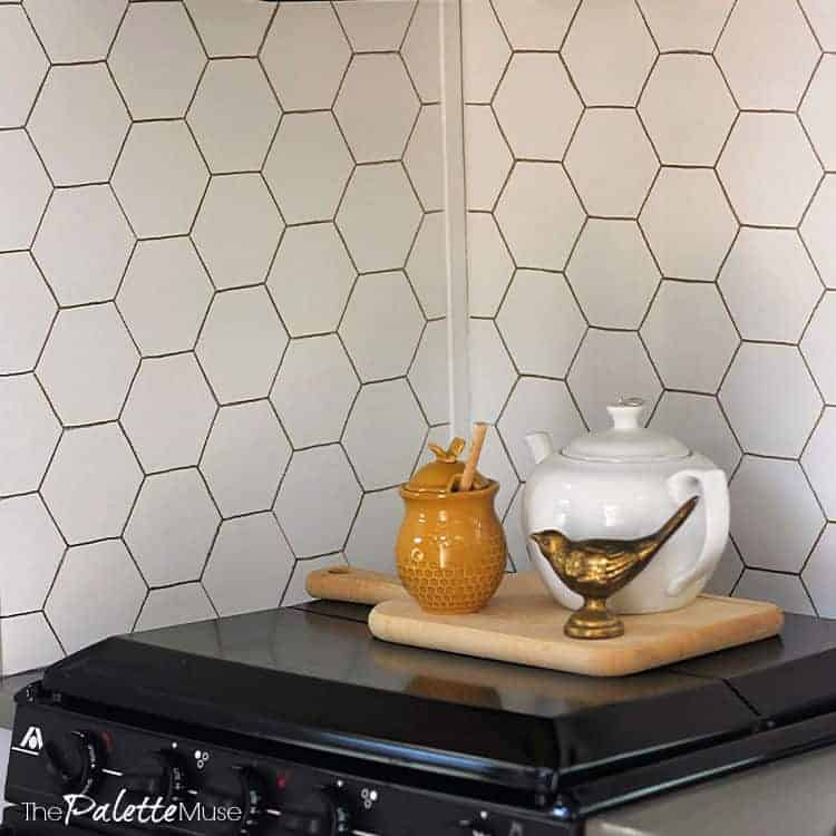 Gold hexagon pattern on white background painted backsplash