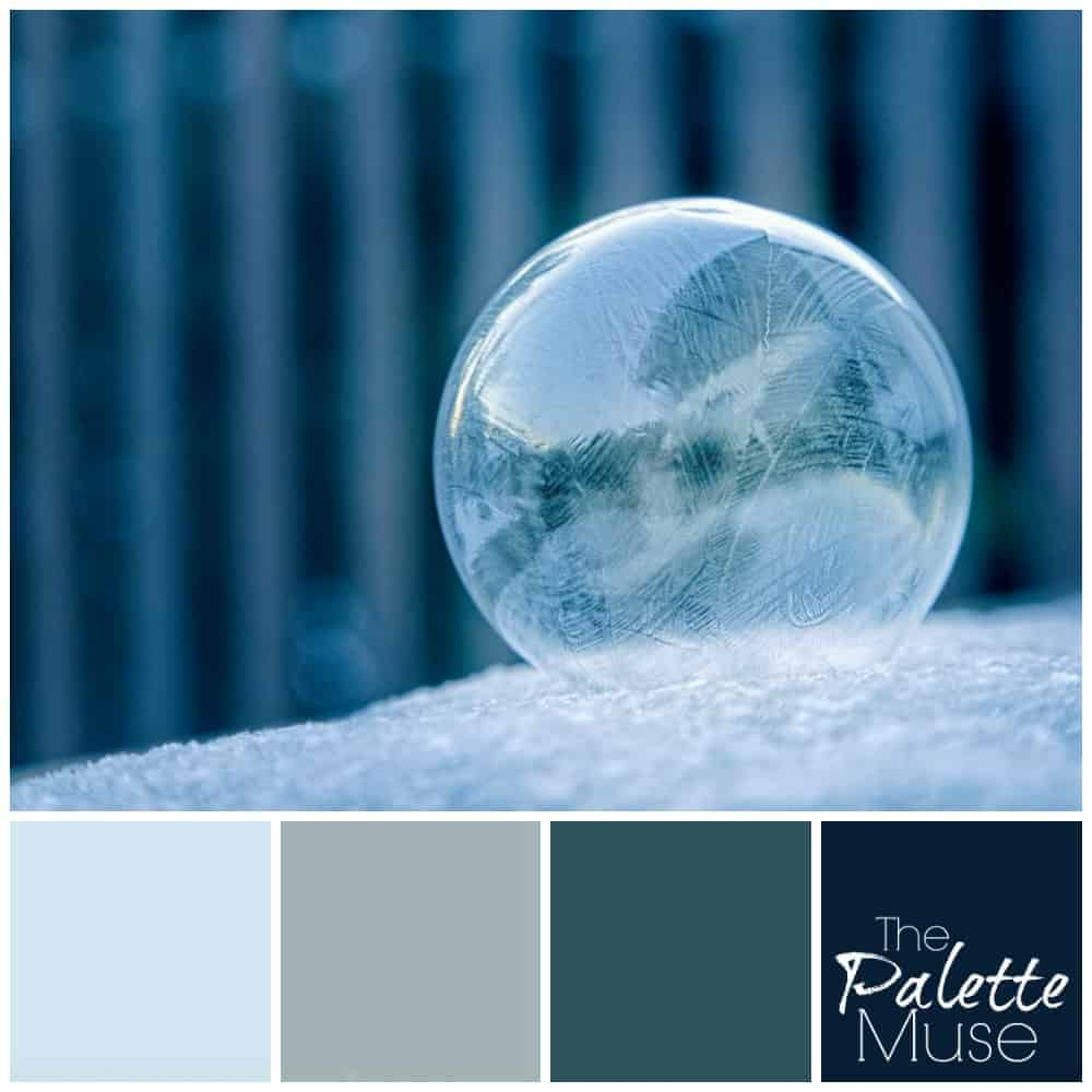 A frost bubble against a blue background provides inspiration for a blue and green color palette.