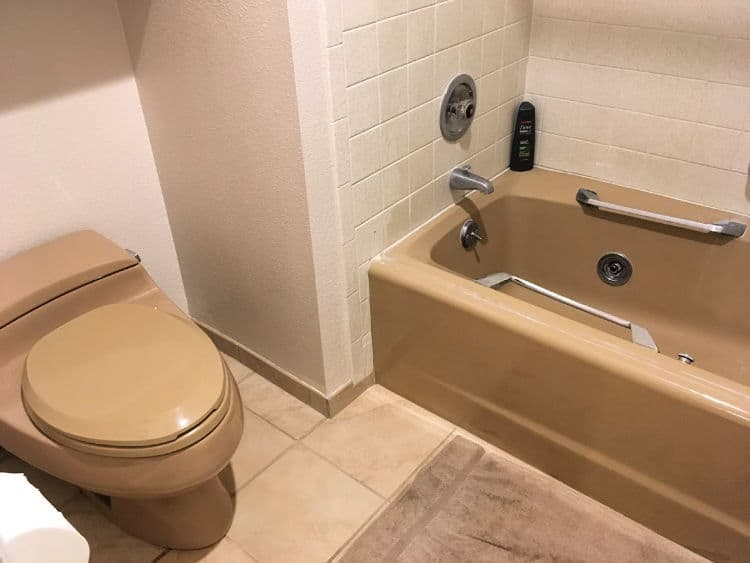 Matching brown toilet and tub.