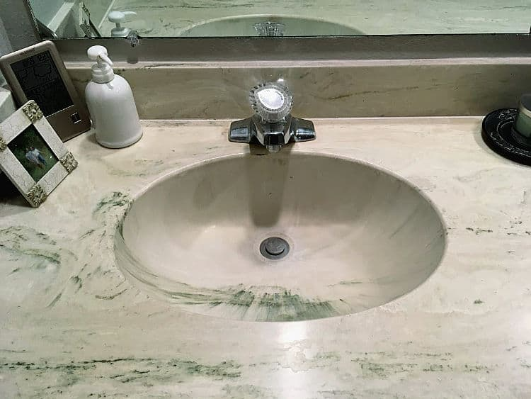 Green cultured marble sink and countertop.