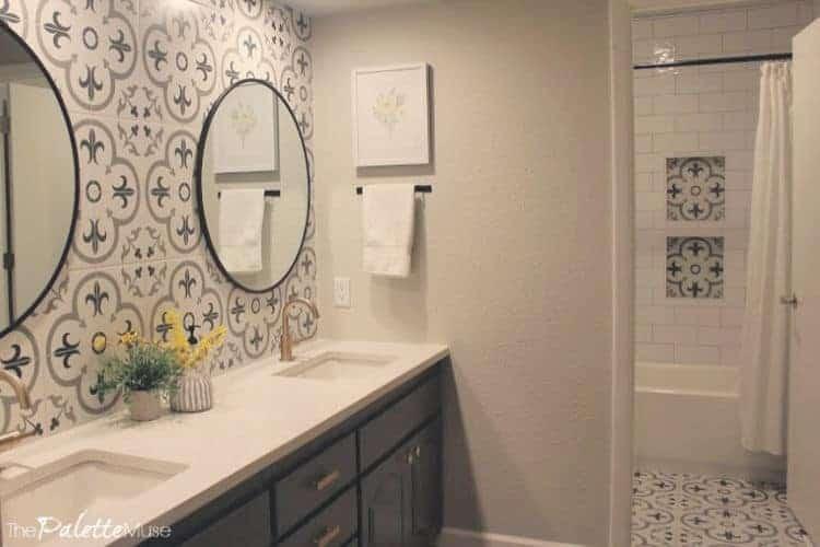 Bright updated bathroom with patterned tile backsplash